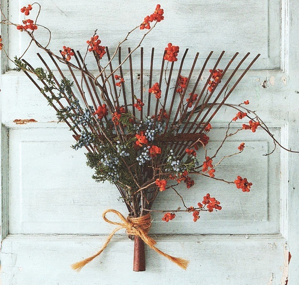 Decorate an old rake instead of a door wreath ~ great idea!  Great for my garden gate.  Note: Or, decorate old rake which is currently holding my small garden tools ~ combine form and function!
