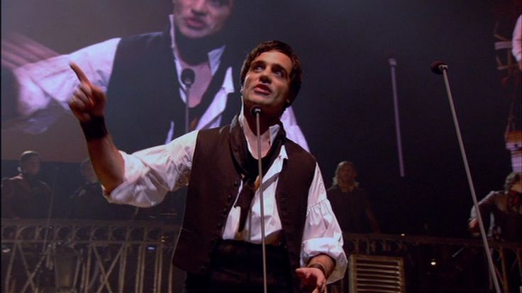 Ramin Karimloo as Enjolras. Amazing, bu The Warlow still reigns as king of this role! :D