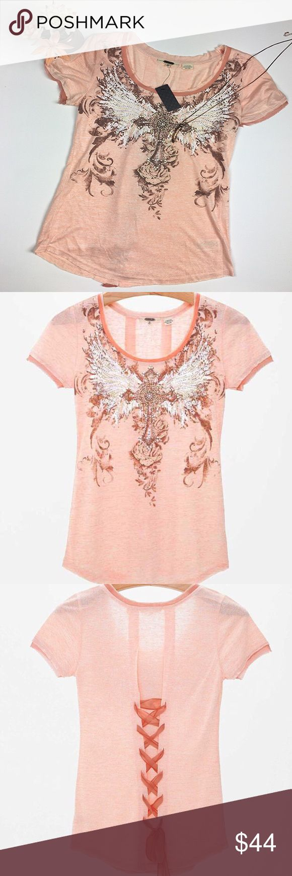"""NWT MISS ME Winged Cross Top This Miss Me top is short sleeve with a gorgeous, detailed, winged cross design on the front, full of embellishments. The back features a crisscross tie, down the middle, with a bow at the bottom. Super cute!   Condition: Brand New with Tags Size: M Color: Peach  Chest: 17"""" Length: 25""""  Material: 71% Rayon 29% Polyester   I LOVE OFFERS! Sorry no trades. Bundle to Save. Miss Me Tops Blouses"""