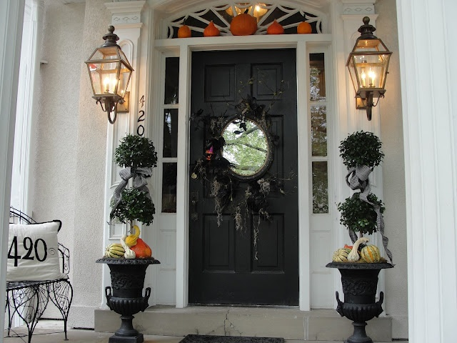 nell hill front door display with urns and pumpkins - Halloween Front Doors