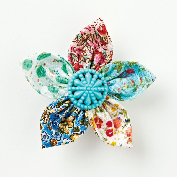 How to make a spring brooch with fabric flowers and vintage buttons | Mollie Makes
