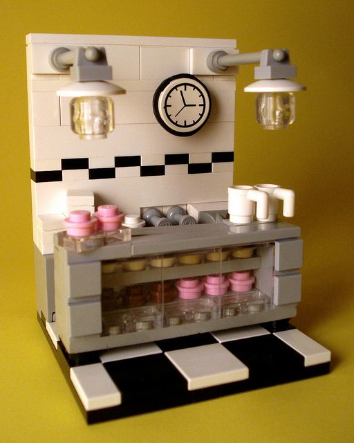 Bakery Vignette  I like: - the shelving and clear front - the lamps