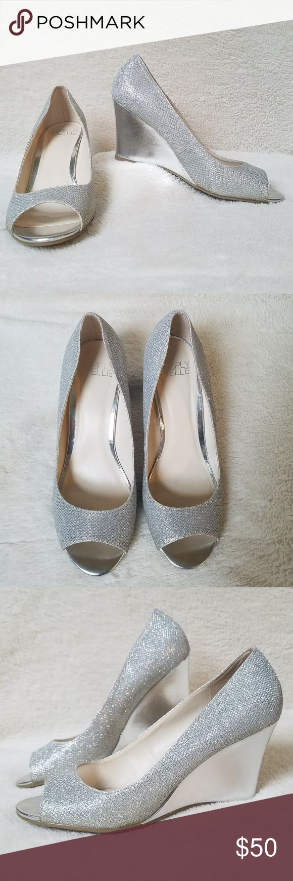 """Simply Pelle David's Bridal silver wedge shoes Simply Pelle """"Wendie"""" silver peep toe wedges; size 8. This brand of shoe is available through David's Bridal and make a beautifully chic addition to your wedding day, or as a mother of the bride/groom shoe! These shoes have a 3"""" wedge heel. Worn once for a wedding. VERY minor wear to the soles, and a couple very minor marks to the right wedge. My guess is they are indentations from resting heel against a chair; I've shown in the pictures…"""