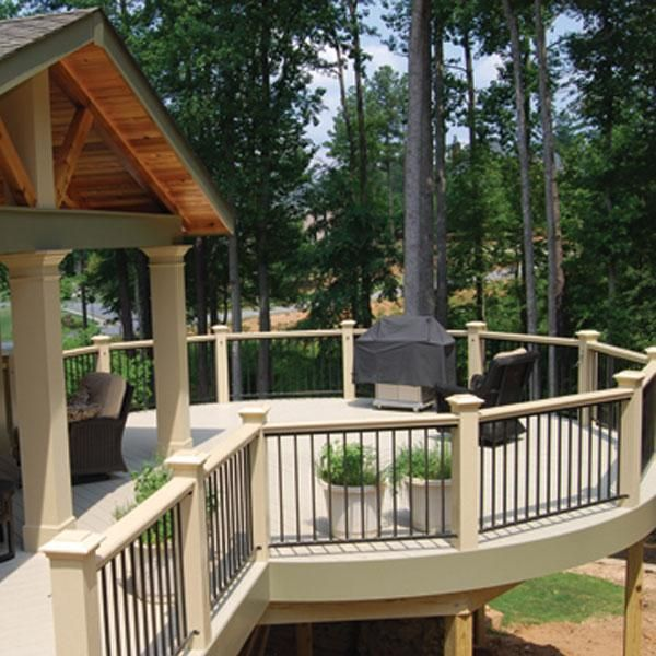 Fortress FE26 Aluminum Deck Railing in Gloss Black. Features FE26 Traditional Prefabricated Iron Panels by Fortress and FE26 Cap Rail Clips
