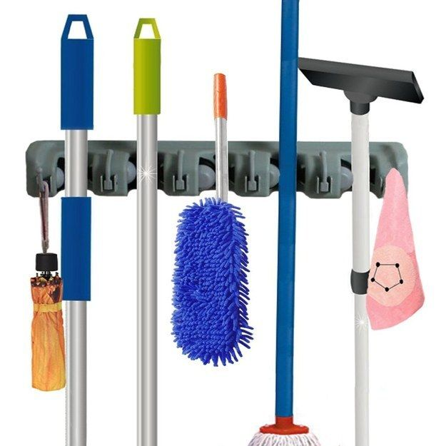 Keep all of your cleaning tools in one place with a wall-mounted broom and mop holder. | 33 Products To Help Disorganized People Get It Together