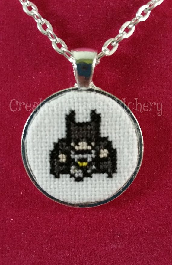Holy Cross stitch Batman! :)    This is a cross stitch pendant 1 in size on a bright silver toned pendant and bright silver toned necklace with