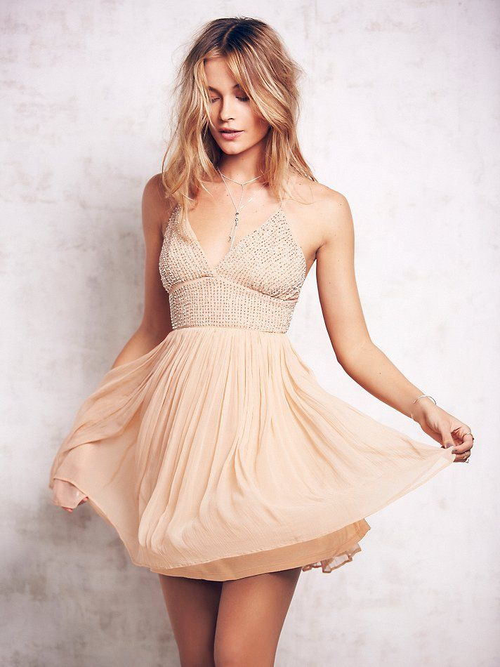 Like A Diamond Dress   Delicate crinkly chiffon mini dress featuring a pleated skirt and a V-neck beaded bust. Low back with adjustable strap detailing.  Hidden side zip.