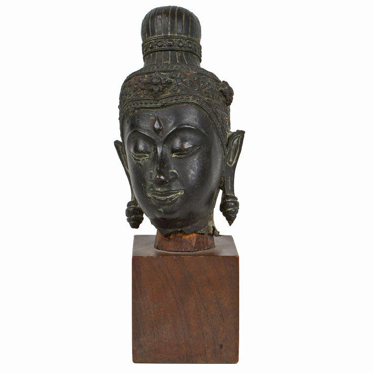 Description A bronze head of Buddha Thailand, wearing elaborate headdress 16 x 7 x 7 cm  Date 17th/18th century  www.collectorstrade.de