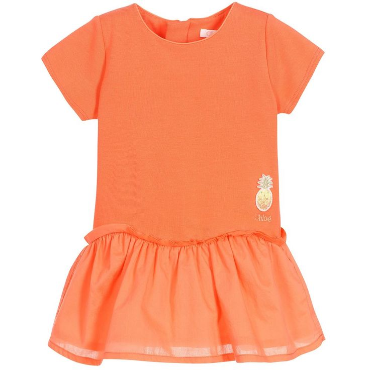 Baby girls apricot dress byChloé. The top is made in soft cotton jersey, with short sleeves, a zip to fasten and an embroidered pineapple with logo. It has a dropped waist and the skirt is made from lightly woven cotton, with a cotton lining and gathers.
