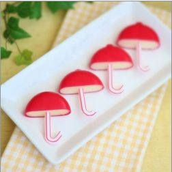 Cut baby bell cheese in half, insert a small piece of straw in the bottom, and serve these adorable umbrellas as snacks at a baby shower!
