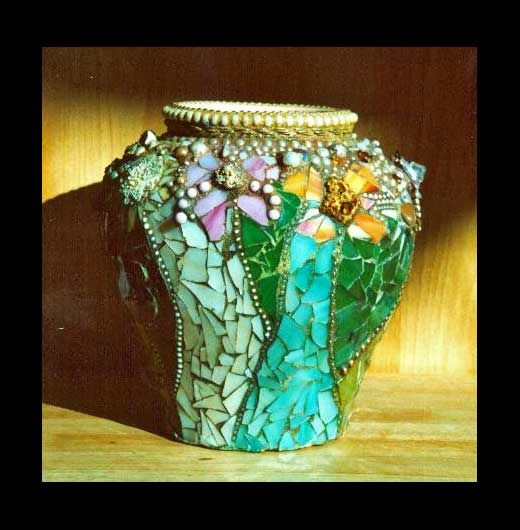 mosaic vase with a neutral color background  http://www.scallonart.com/vases.html#