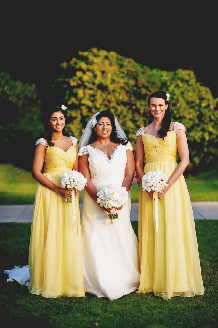Bridesmaids wear yellow dresses with white lace capped sleeves | Photography by http://www.rossharvey.com/