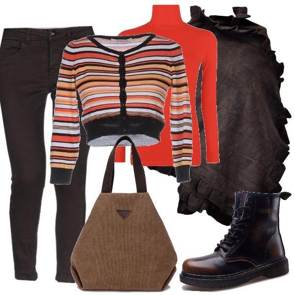 Comodità e un pizzico di colore spendendo pochissimo. I pantaloni slim fit marroni sono abbinati ad un dolce vita arancio e ad uno scaldacuore a righe. Sopra si consiglia una calda mantella della stessa tonalità dei pantaloni, mentre le scarpe sono degli stivaletti con i lacci e la borsa è in tela.