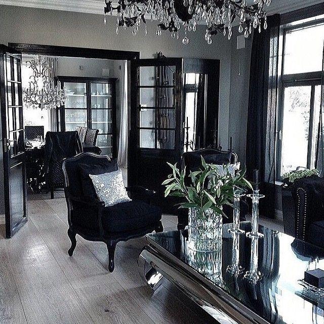 Lavish, glamorous, light grey, black, and silver home interior.
