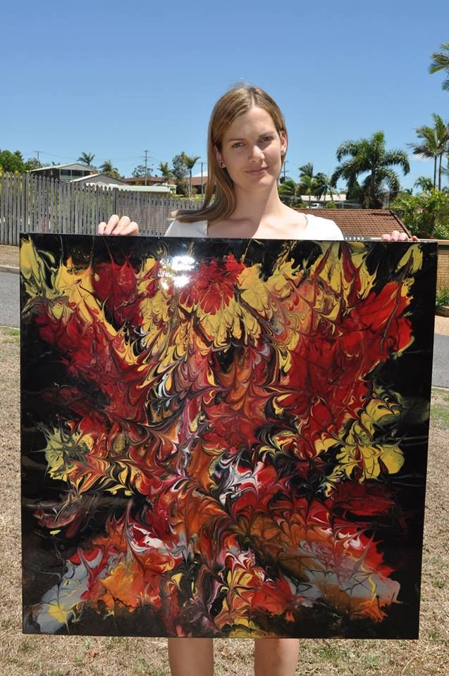 Artist Jodie Lyle with her large abstract resin artwork  www.picturesqueresinart.com