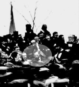 One of the only two confirmed photos of Abraham Lincoln at Gettysburg, taken about noon, just after Lincoln arrived and some three hours before the speech. To Lincoln's right is his bodyguard, Ward Hill Lamon.