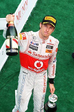 Jenson Button (GBR) McLaren on the podium. Formula One World Championship, Rd 2, Malaysian Grand Prix, Race, Sepang, Malaysia, Sunday, 10 April 2011