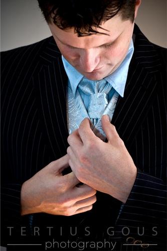 Neville fixing his tie.