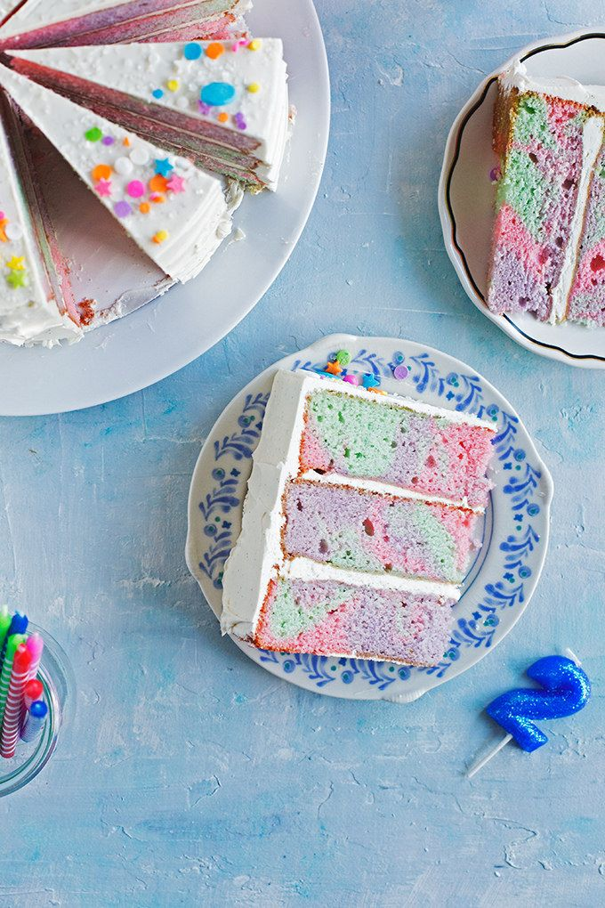 Rainbow Marble Layer Cake - A festive cake with rainbow marbled vanilla bean + buttermilk cake layers frosted with swirls of silky vanilla bean swiss meringue buttercream. from @cindyr