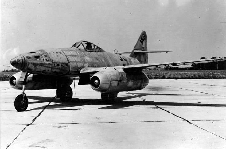"A Messerschmitt Me 262 Schwalbe (English: ""Swallow"") is photographed at an airfield in Frankfurt after her test pilot chose to surrender to US forces on March 31, 1945. The Me-262 was the world's first operational jet-powered fighter aircraft and claimed 542 Allied kills during her brief deployment in 1945. This particular unit was transported back to the US but it crashed during testing in 1946. The test pilot ejected safely."