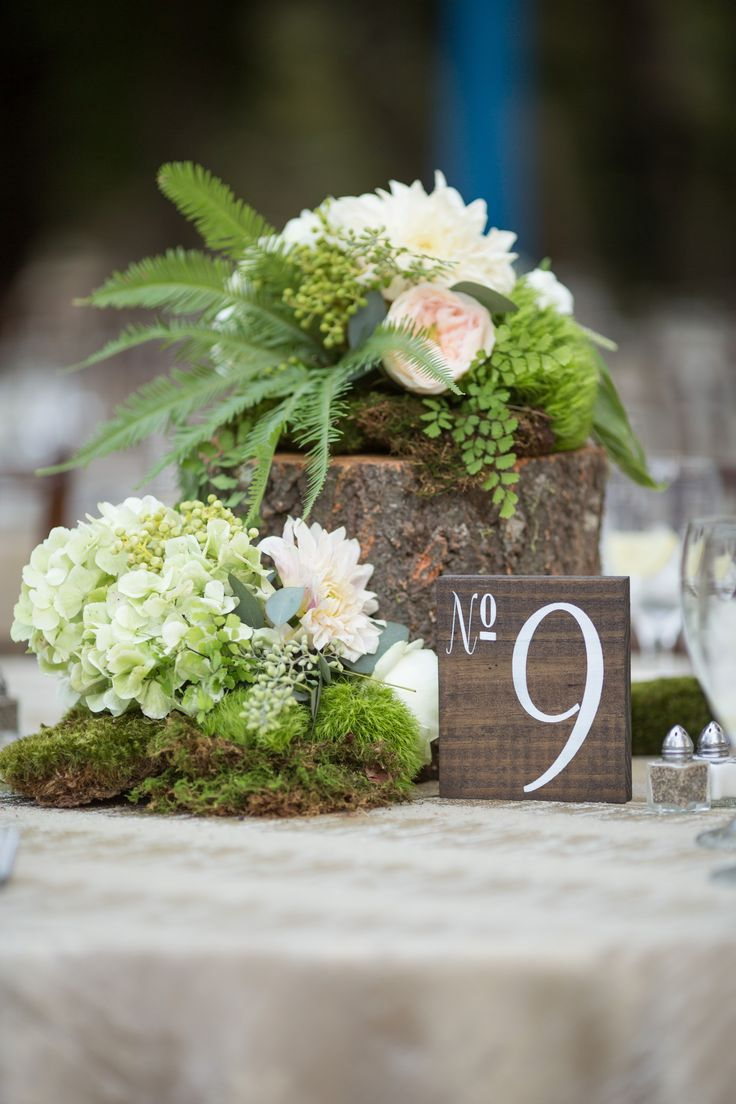 Tree stump moss and floral centerpiece by @Katie Daniell  with stained wood table number! Design by A Good Affair Wedding & Event Production; Photo Cred: David Manning Photographers www.agoodaffair.com