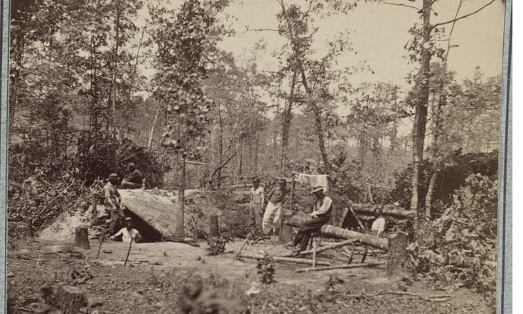 Soldiers surround a bombproof shelter during the siege of Petersburg, 1864. Photo via Library of Congress.