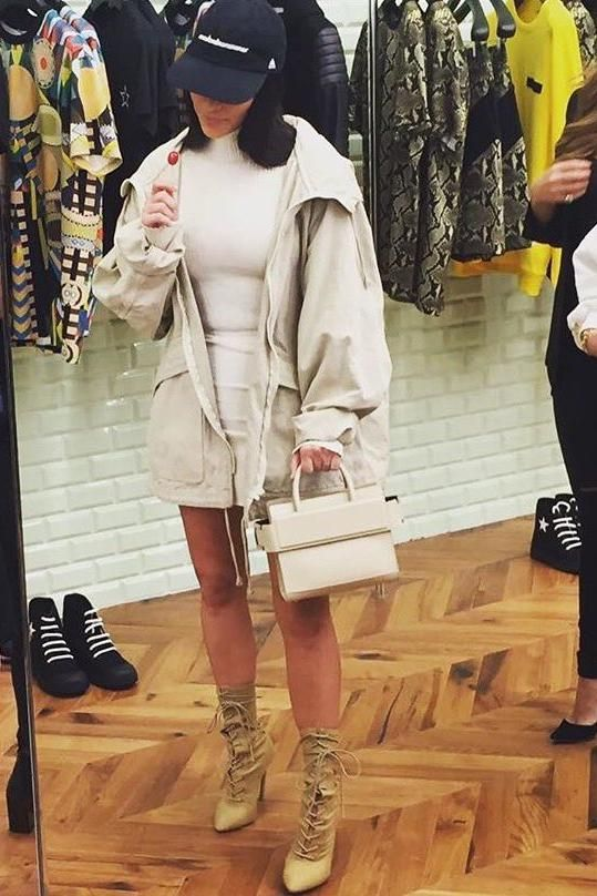 Kim Kardashian wearing Yeezy Season 4 Lace-Up Boots, Givenchy Horizon Nano-Bag, Wolford Merino Dress, Adidas Yeezy Season 4 Calabasas Hat and Yeezy Season 4 Hooded Jacket