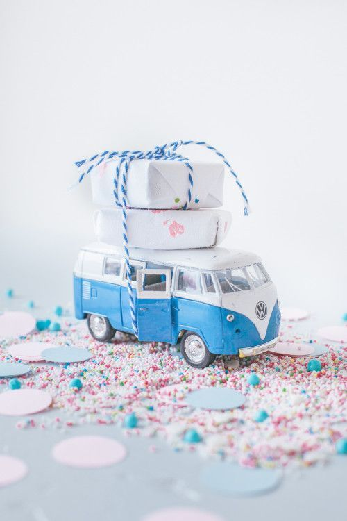 Clever little present idea. Wrap small gifts and tie them to the top of vehicles with coordinating colors. #giftwrap