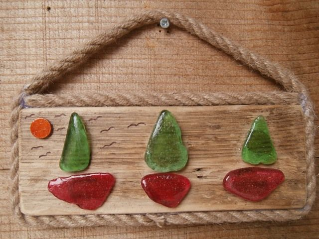 Driftwood, pebbles, sand, seaglass.