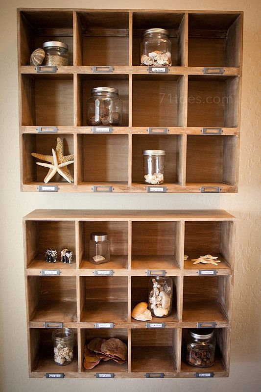 label cubbies w/ places you've traveled and then display keepsakes in your home! brilliant.