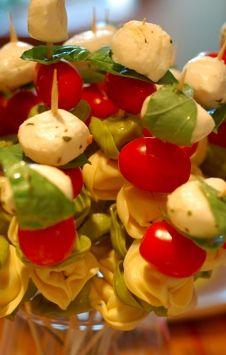 white and green tortellini, tomato, fresh mozzarella wrapped in basil.