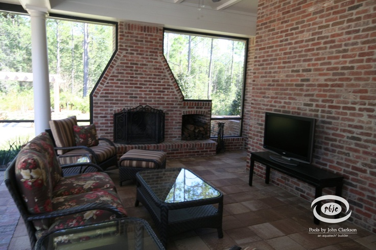 Outdoor Living Room Positioned Near Brick Wood Burning