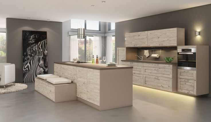 Jasne, przestronne i funkcjonalne wnętrze kuchni – aranżacja firmy Atrii.