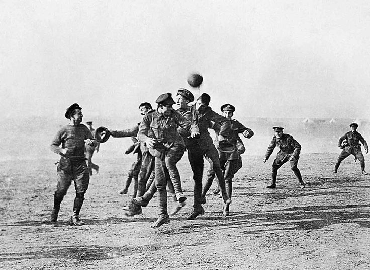 "During the Christmas Truce of 1914, German and British soldiers play a game of soccer in the ""no man's land"" between trenches."