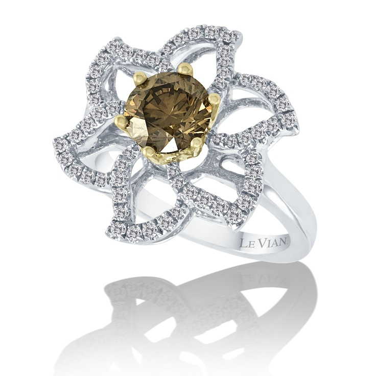 With a Chocolate Diamond® center and Vanilla Diamond® petals, this Vanilla Gold® ring is a flower that is blooming all year round.