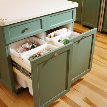 """Recyclables in a base cabinet.  Love the idea but would want to put """"toe pulls"""" at the bottom so you do not need to touch w/ your hands!!"""