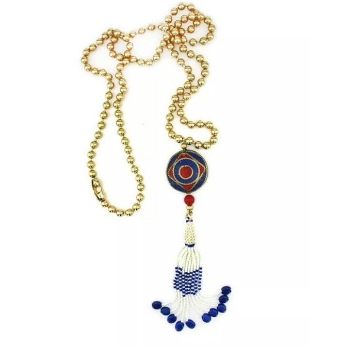 stylish boho chic style necklace  with modern connection .    materials: Gold plated purple bead pompon  handmade with love.