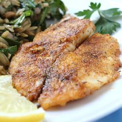 Pan-Seared Tilapia Recipe-Add old bay, paprika, garlic salt to flour.  Be sure to salt when take out of pan