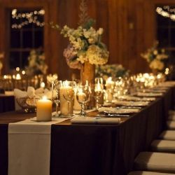Twinkle lights, candles, estate seating and rustic decor in this romantic wedding at Charleston's Boone Hall Cotton Dock!