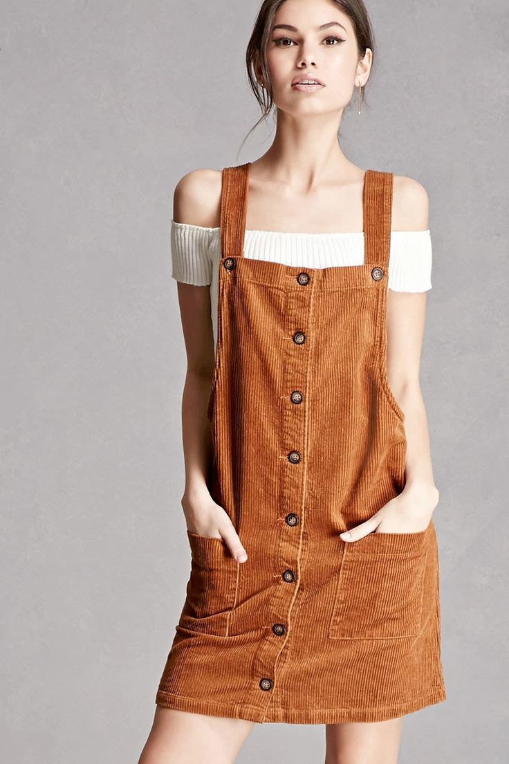 A corduroy overall dress featuring a button front, adjustable straps, and front patch pockets. This is an independent brand and not a Forever 21 branded item.