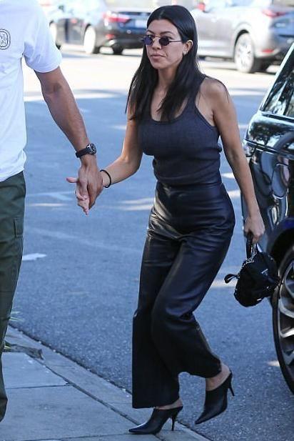 ee0eace6f39d Kourtney Kardashian wearing Celine Black Pointed Mules, Prada Vela Backpack  and Roberi & Fraud Doris 2.0 Sunglasses