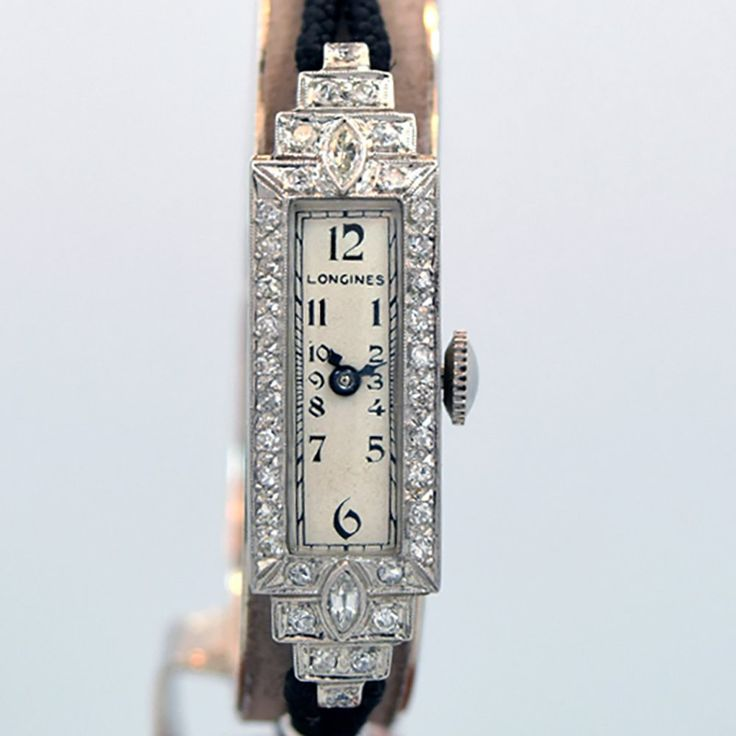 1933 Vintage Longines Ladies Platinum and Diamonds watch with Silver Dial with Black Arabic Numbers with Black Braided Rope Bracelet. Triple Signed. Swiss Case Very Good Case Original, Case Dimensions