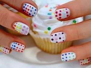 They make a dotting tool you can use to make tiny dots on your nails; it makes it a breeze to make fun designs like these!  I did a dice pattern on my toes using it....super cute!