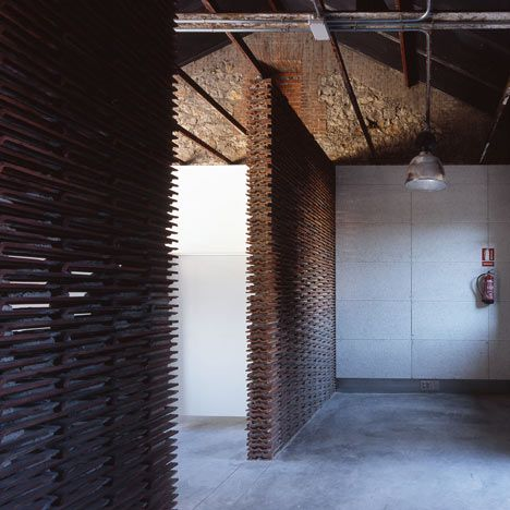 Ceiling tiles as interior walls in Warehouse 8B by Arturo Franco