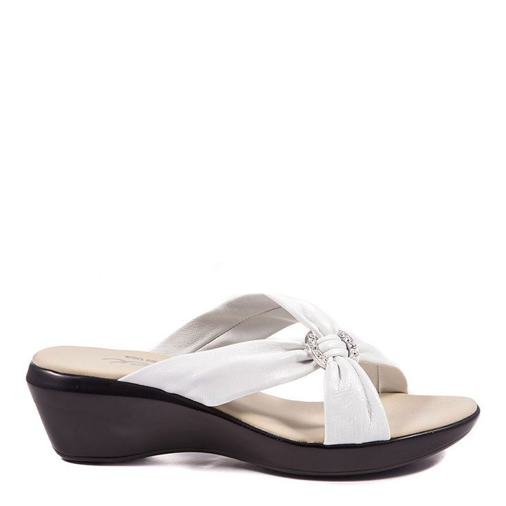 Onex Shoes are among the most comfortable white dress low wedges. If your  looking for both comfort and style, these are the wedges for you.