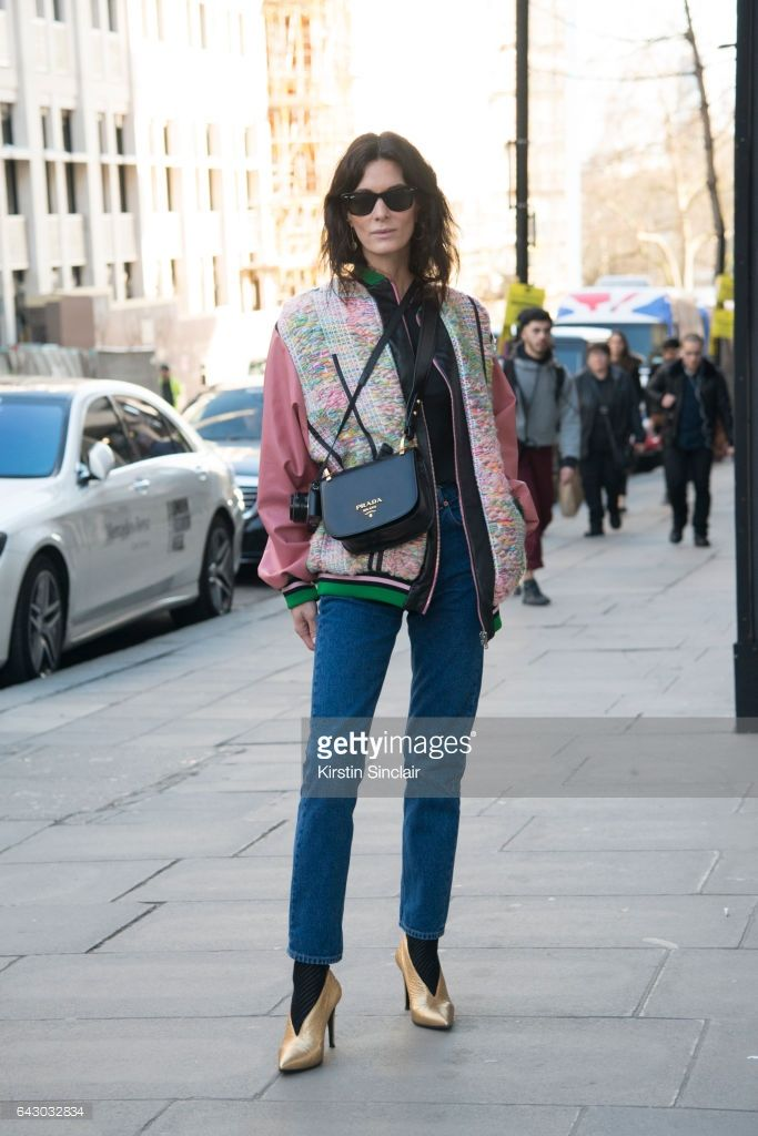 Fashion Blogger Hedvig Opshaug wears a Roberta Einer jacket, Balenciaga jeans, Aeyde shoes, Prada bag and Ray-Ban sunglasses on day 1 of London Womens Fashion Week Autumn/Winter 2017, on February 17, 2017 in London, England.