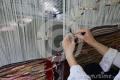 Traditional weaving loom - woman hands weaving.