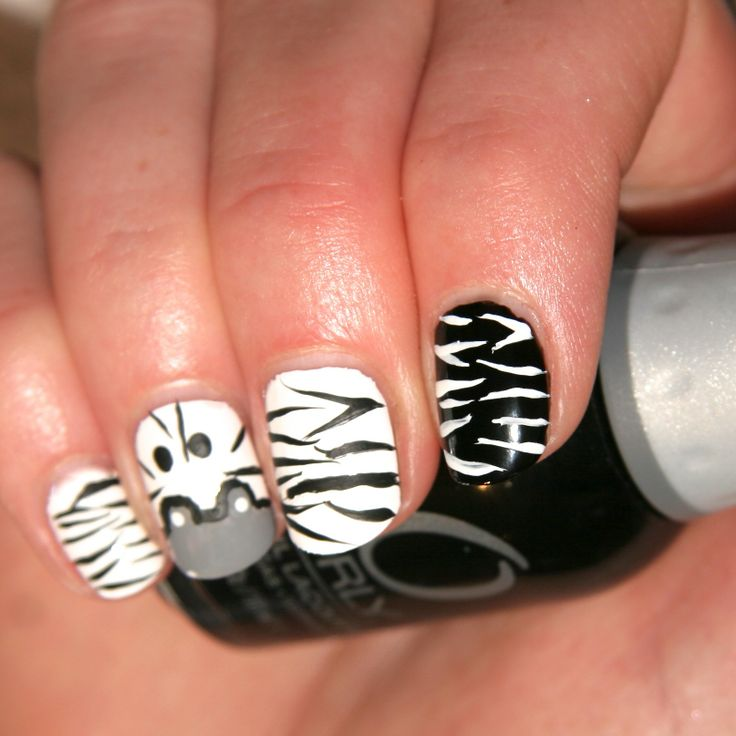 "Your Stripes, our Khumba!!   Who called us Zebras boring anyway!?  We hung out at a cool nail bar this week, totally IN with the ""IN herd"" and bang on trend!!  Check out this ""HOW TO"" VIDEO we made to help you Stripe to Style this festive season.  http://youtu.be/6YCdZL8xIlM #KhumbaStyle #nails #nailart"