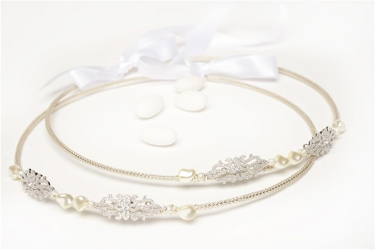 Cherish Wedding Crown Stefana capture the natural sparkle of the Swarovski crystal, pearls and pave crystal filigrees enhancing silver plated rings.