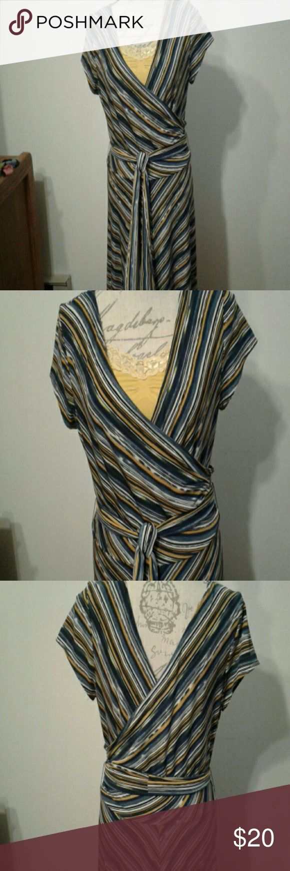 "Dress K Studio soft fitted dress. Polyester /spandex. A small size 14 Smartly striped in blues,  yellow and white.  Belt can be worn on front or side. 27 "" from  waist to hem. Paired with my yellow cami- style tank top or wear alone. Dress $20 with yellow cami $30. K Studio  Dresses Midi"